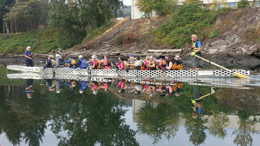 forty foot dragon boat making the first ripples of the day in the river